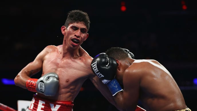 NEW YORK, NY - DECEMBER 02:  Rey Vargas lands a punch against Oscar Negrete during their Super Bantamweight bout at Madison Square Garden on December 2, 2017 in New York City.  (Photo by Al Bello/Getty Images)