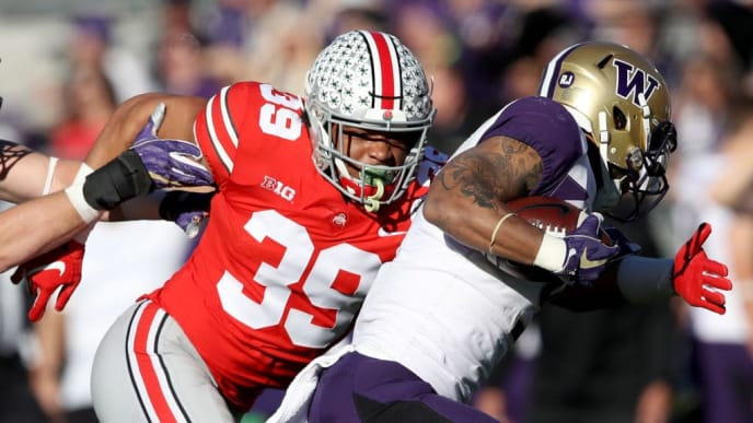 PASADENA, CA - JANUARY 01:  Malik Harrison #39 of the Ohio State Buckeyes attempts to make a tackle during the first half in the Rose Bowl Game presented by Northwestern Mutual at the Rose Bowl on January 1, 2019 in Pasadena, California.  (Photo by Sean M. Haffey/Getty Images)