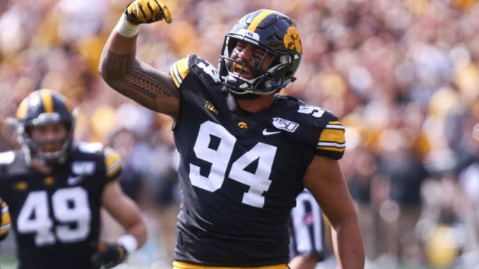 IOWA CITY, IOWA - SEPTEMBER 07:  Defensive end A.J. Epenesa #94 of the Iowa Hawkeyes celebrates his sack during the first half against the Rutgers Scarlet Knights on August 31, 2019 at Kinnick Stadium in Iowa City, Iowa.  (Photo by Matthew Holst/Getty Images)