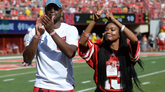 LINCOLN, NE - SEPTEMBER 23: Basketball star Dwyane Wade and actress Gabrielle Union greet fans during a break in the game between the Nebraska Cornhuskers and the Rutgers Scarlet Knights at Memorial Stadium on September 23, 2017 in Lincoln, Nebraska. (Photo by Steven Branscombe/Getty Images)