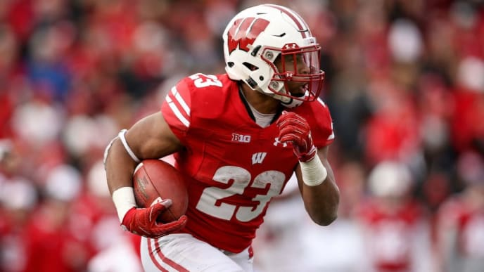 MADISON, WISCONSIN - NOVEMBER 03:   Jonathan Taylor #23 of the Wisconsin Badgers runs with the ball in the third quarter against the Rutgers Scarlet Knights at Camp Randall Stadium on November 03, 2018 in Madison, Wisconsin. (Photo by Dylan Buell/Getty Images)