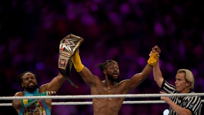 WWE Superstar Kofi Kingston (C) celebrates at the end of the World Wrestling Entertainment (WWE) Super Showdown event in Saudi Arabia's Red Sea port city of Jeddah late on January 7, 2019. (Photo by Amer HILABI / AFP)        (Photo credit should read AMER HILABI/AFP/Getty Images)