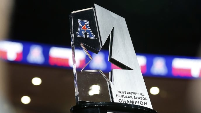 HOUSTON, TEXAS - MARCH 07: Houston Cougars lift the AAC regular season trophy as they clinched a share with a win against the Southern Methodist Mustangs during the first half at Fertitta Center on March 07, 2019 in Houston, Texas. (Photo by Bob Levey/Getty Images)