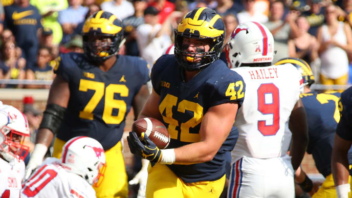 ANN ARBOR, MI - SEPTEMBER 15: Ben Mason #42 of the Michigan Wolverines celebrates a first half touchdown while playing the Southern Methodist Mustangs on September 15, 2018 at Michigan Stadium in Ann Arbor, Michigan. (Photo by Gregory Shamus/Getty Images)