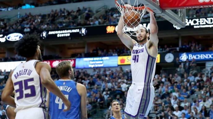 DALLAS, TEXAS - MARCH 26: Kosta Koufos #41 of the Sacramento Kings dunks the against Dirk Nowitzki #41 of the Dallas Mavericks in the first half at American Airlines Center on March 26, 2019 in Dallas, Texas. NOTE TO USER: User expressly acknowledges and agrees that, by downloading and or using this photograph, User is consenting to the terms and conditions of the Getty Images License Agreement. (Photo by Tom Pennington/Getty Images)