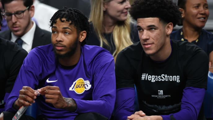 LAS VEGAS, NV - OCTOBER 08:  Brandon Ingram (L) #14 and Lonzo Ball #2 of the Los Angeles Lakers sit on the bench during their preseason game against the Sacramento Kings at T-Mobile Arena on October 8, 2017 in Las Vegas, Nevada. Ball wears a #VegasStrong T-shirt to honor victims of last Sunday's mass shooting. On October 1, Stephen Paddock killed at least 58 people and injured more than 450 after he opened fire on a large crowd at the Route 91 Harvest country music festival. The massacre is one of the deadliest mass shooting events in U.S. history. Los Angeles won 75-69. NOTE TO USER: User expressly acknowledges and agrees that, by downloading and or using this photograph, User is consenting to the terms and conditions of the Getty Images License Agreement.  (Photo by Ethan Miller/Getty Images)