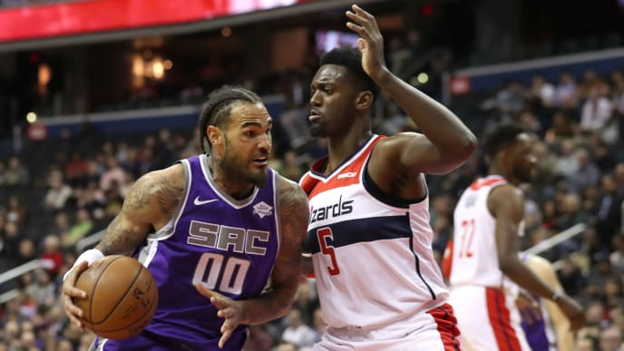 WASHINGTON, DC - MARCH 11: Willie Cauley-Stein #00 of the Sacramento Kings drives to the basket against Bobby Portis #5 of the Washington Wizards in the first half at Capital One Arena on March 11, 2019 in Washington, DC. NOTE TO USER: User expressly acknowledges and agrees that, by downloading and or using this photograph, User is consenting to the terms and conditions of the Getty Images License Agreement. (Photo by Rob Carr/Getty Images)