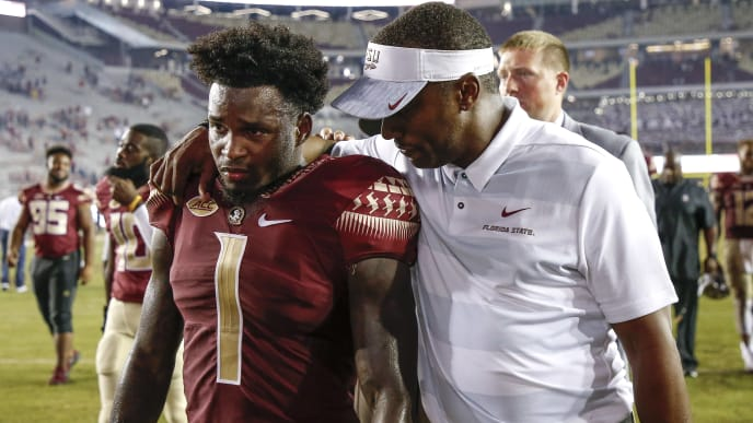 TALLAHASSEE, FL - SEPTEMBER 8: Head Coach Willie Taggart talk with Cornerback Levonta Taylor #1 of the Florida State Seminoles after the game against the Samford Bulldogs at Doak Campbell Stadium on Bobby Bowden Field on September 8, 2018 in Tallahassee, Florida. The Seminoles defeated the Bulldogs 36 to 26. (Photo by Don Juan Moore/Getty Images)