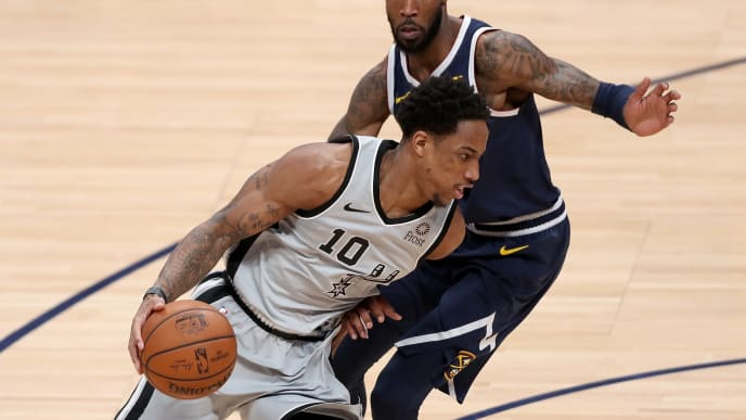 DENVER, COLORADO - APRIL 27: Demar Derozan #10 of the San Antonio Spurs drives against Will Barton of the Denver Nuggets in the second quarter during Game Seven of the first round of the 2019 NBA Western Conference Playoffs at the Pepsi Center on April 27, 2019 in Denver, Colorado. NOTE TO USER: User expressly acknowledges and agrees that, by downloading and or using this photograph, User is consenting to the terms and conditions of the Getty Images License Agreement. (Photo by Matthew Stockman/Getty Images)