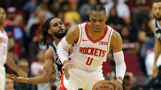 HOUSTON, TEXAS - OCTOBER 16: Russell Westbrook #0 of the Houston Rockets is pressured by Patty Mills #8 of the San Antonio Spurs during the first quarter at Toyota Center on October 16, 2019 in Houston, Texas. NOTE TO USER: User expressly acknowledges and agrees that, by downloading and/or using this photograph, user is consenting to the terms and conditions of the Getty Images License Agreement. (Photo by Bob Levey/Getty Images)