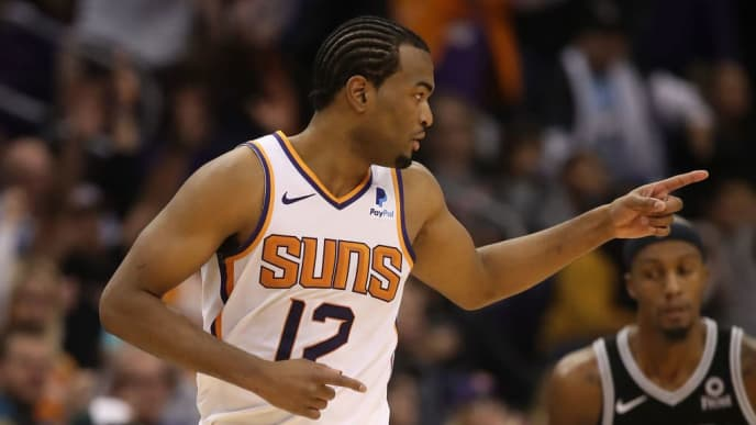 PHOENIX, AZ - NOVEMBER 14:  TJ Warren #12 of the Phoenix Suns reacts after hititng a three-point shot during the second half of the NBA game against the San Antonio Spurs at Talking Stick Resort Arena on November 14, 2018 in Phoenix, Arizona.  The Suns defeated the Spurs 116-96. NOTE TO USER: User expressly acknowledges and agrees that, by downloading and or using this photograph, User is consenting to the terms and conditions of the Getty Images License Agreement.  (Photo by Christian Petersen/Getty Images)
