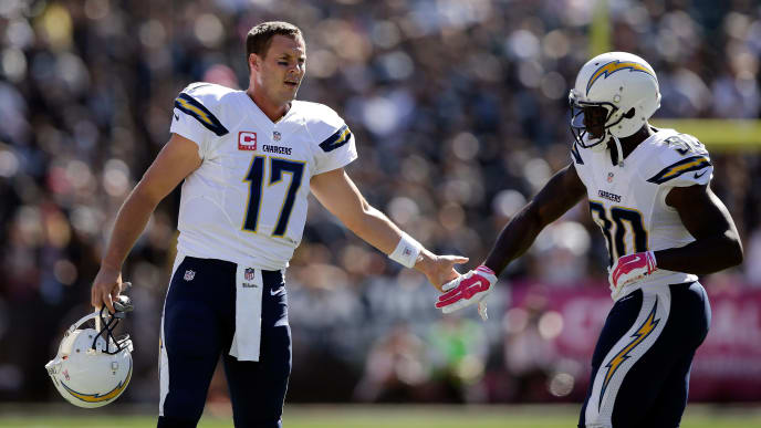 OAKLAND, CA - OCTOBER 12:  Philip Rivers #17 and Malcom Floyd #80 of the San Diego Chargers high five after Rivers threw a touchdown pass to Eddie Royal #11 of the San Diego Chargers in the first quarter of their game against the Oakland Raiders at O.co Coliseum on October 12, 2014 in Oakland, California.  (Photo by Ezra Shaw/Getty Images)
