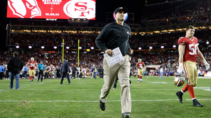 SANTA CLARA, CA - DECEMBER 20:  Head coach Jim Harbaugh of the San Francisco 49ers runs off the field after the 49ers lose 38-35 in overtime to the San Diego Chargers at Levi's Stadium on December 20, 2014 in Santa Clara, California.  (Photo by Ezra Shaw/Getty Images)