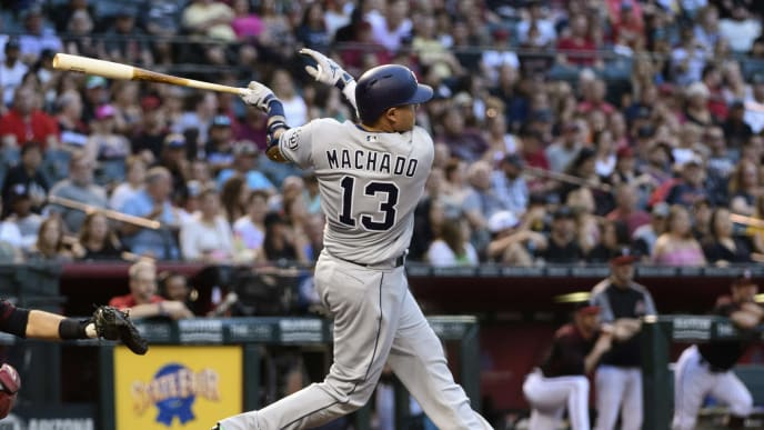 PHOENIX, ARIZONA - SEPTEMBER 28: Manny Machado #13 of the San Diego Padres hits a two run home run in the third inning of the MLB game against the Arizona Diamondbacks at Chase Field on September 28, 2019 in Phoenix, Arizona. (Photo by Jennifer Stewart/Getty Images)