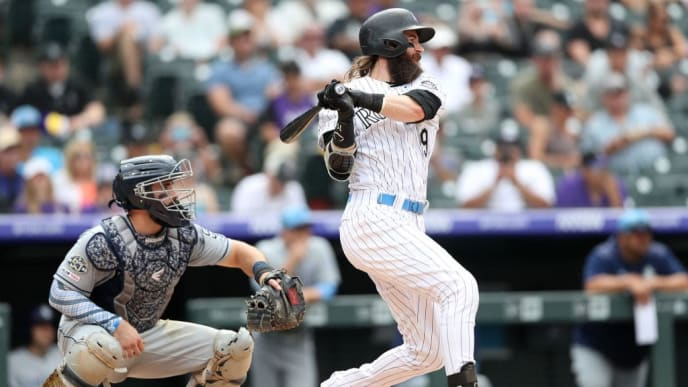 DENVER, COLORADO - JUNE 16: Charlie Blackmon #19 of the Colorado Rockies hits a RBI single in the sixth inning against the San Diego Padres at Coors Field on June 16, 2019 in Denver, Colorado. (Photo by Matthew Stockman/Getty Images)