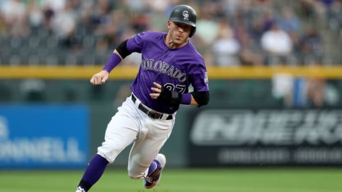 DENVER, COLORADO - JUNE 13: Trevor Story #27 of the Colorado Rockies rounds third base to score on a Daniel Murphy single in the first inning against the San Diego Padres at Coors Field on June 13, 2019 in Denver, Colorado. (Photo by Matthew Stockman/Getty Images)