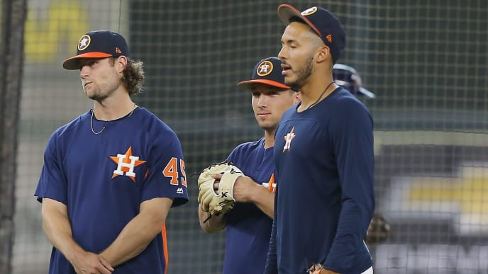 HOUSTON, TX - APRIL 06:  Marwin Gonzalez #9, Gerrit Cole #45, Alex Bregman #2 and Carlos Correa #1 of the Houston Astros attend batting practice at Minute Maid Park on April 6, 2018 in Houston, Texas.  (Photo by Bob Levey/Getty Images)