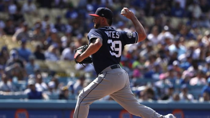 LOS ANGELES, CALIFORNIA - JULY 07: Closing pitcher Kirby Yates #39 of the San Diego Padres pitches in the ninth inning during a MLB game against the Los Angeles Dodgers at Dodger Stadium on July 07, 2019 in Los Angeles, California. The Padres defeated the Dodgers 5-3. (Photo by Victor Decolongon/Getty Images)