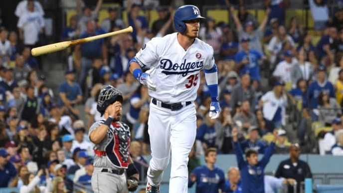 LOS ANGELES, CA - JULY 04: Cody Bellinger #35 of the Los Angeles Dodgers throws his bat as he runs to first after hitting a solo home run in the sixth inning off the game against the San Diego Padres at Dodger Stadium on July 4, 2019 in Los Angeles, California. (Photo by Jayne Kamin-Oncea/Getty Images)