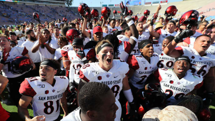 LOS ANGELES, CALIFORNIA - SEPTEMBER 07:  Ethan Dedeaux #81, Connor Mitchell #58 and the San Diego State Aztecs react after defeating the UCLA Bruins 23-14 in a game on September 07, 2019 in Los Angeles, California. (Photo by Sean M. Haffey/Getty Images)