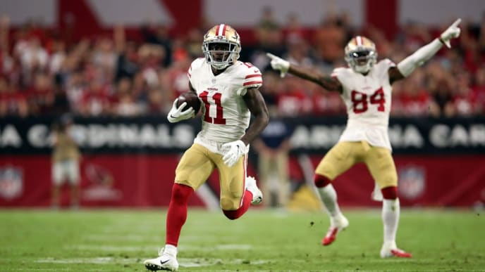 GLENDALE, AZ - OCTOBER 28:  Wide receiver Marquise Goodwin #11 of the San Francisco 49ers scores a 55-yard touchdown during the third quarter against the Arizona Cardinals at State Farm Stadium on October 28, 2018 in Glendale, Arizona.  (Photo by Christian Petersen/Getty Images)