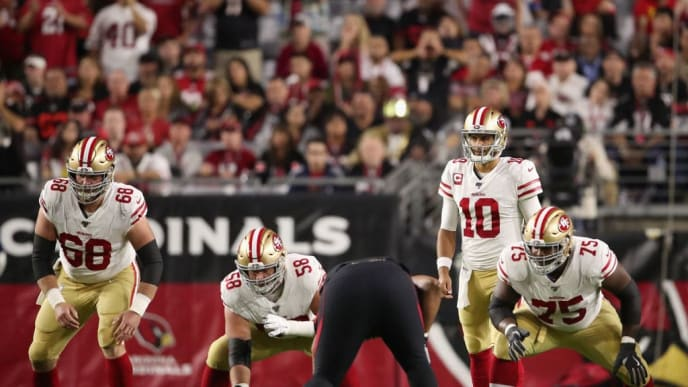 GLENDALE, ARIZONA - OCTOBER 31: Quarterback Jimmy Garoppolo #10 of the San Francisco 49ers prepares to take the snap from center Weston Richburg #58 during the first half of the NFL game against the Arizona Cardinals at State Farm Stadium on October 31, 2019 in Glendale, Arizona. (Photo by Christian Petersen/Getty Images)