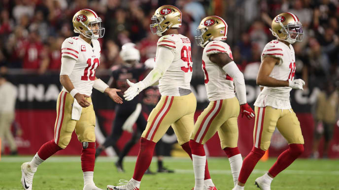 GLENDALE, ARIZONA - OCTOBER 31: Quarterback Jimmy Garoppolo #10 of the San Francisco 49ers high fives defensive tackle DeForest Buckner #99 during the second half of the NFL game against the Arizona Cardinals at State Farm Stadium on October 31, 2019 in Glendale, Arizona. The 49ers defeated the Cardinals 28-25. (Photo by Christian Petersen/Getty Images)