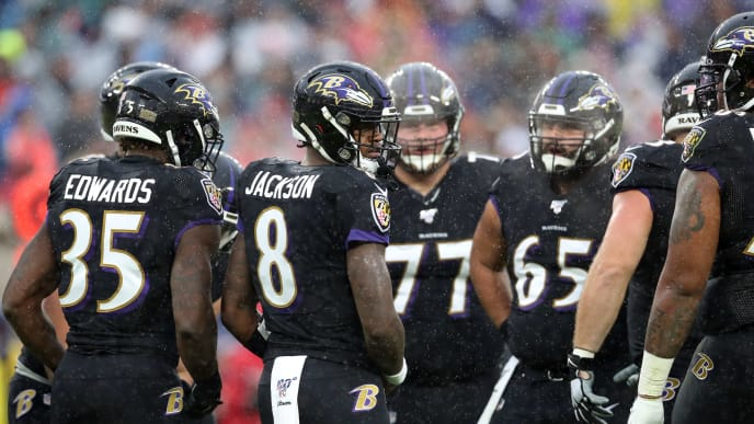 BALTIMORE, MARYLAND - DECEMBER 01: Lamar Jackson #8 of the Baltimore Ravens looks on from the huddle against the San Francisco 49ers at M&T Bank Stadium on December 01, 2019 in Baltimore, Maryland. (Photo by Rob Carr/Getty Images)