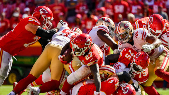 KANSAS CITY, MO - SEPTEMBER 23: Kareem Hunt #27 of the Kansas City Chiefs fights through a pile of players on a run during the fourth quarter of the game against the San Francisco 49ers at Arrowhead Stadium on September 23rd, 2018 in Kansas City, Missouri. (Photo by Peter Aiken/Getty Images)