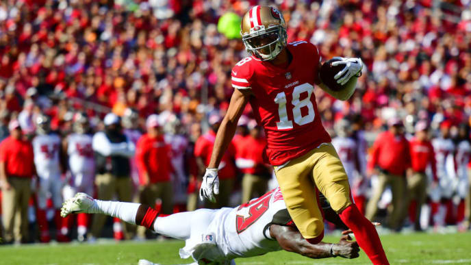 TAMPA, FLORIDA - NOVEMBER 25: Dante Pettis #18 of the San Francisco 49ers catches a 13-yard pass for a touchdown in the second quarter against the Tampa Bay Buccaneers at Raymond James Stadium on November 25, 2018 in Tampa, Florida. (Photo by Julio Aguilar/Getty Images)
