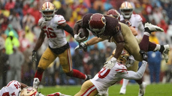 LANDOVER, MARYLAND - OCTOBER 20: Running back Adrian Peterson #26 of the Washington Redskins is tackled by cornerback Jimmie Ward #20 of the San Francisco 49ers during the first half at FedExField on October 20, 2019 in Landover, Maryland. (Photo by Patrick Smith/Getty Images)