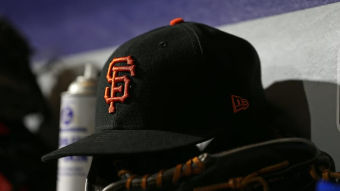 PHILADELPHIA, PA - MAY 08: A New Era cap of the San Francisco Giants sits in the dugout during a game against the Philadelphia Phillies at Citizens Bank Park on May 8, 2018 in Philadelphia, Pennsylvania. The Phillies defeated the Giants 4-2. (Photo by Rich Schultz/Getty Images)