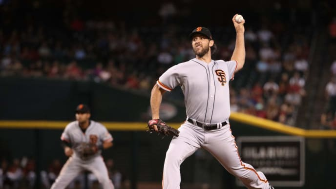 PHOENIX, ARIZONA - AUGUST 18:  Starting pitcher Madison Bumgarner #40 of the San Francisco Giants pitches against the Arizona Diamondbacks during the first inning of the MLB game at Chase Field on August 18, 2019 in Phoenix, Arizona. (Photo by Christian Petersen/Getty Images)