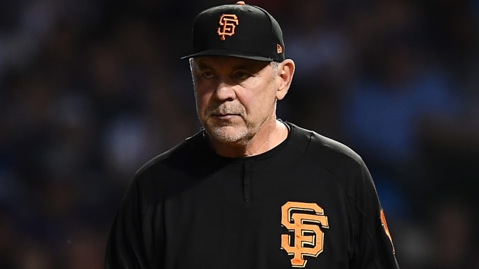 CHICAGO, ILLINOIS - AUGUST 20:  Manager Bruce Bochy #15 of the San Francisco Giants walks to the mound during the sixth inning against the Chicago Cubs at Wrigley Field on August 20, 2019 in Chicago, Illinois. (Photo by Stacy Revere/Getty Images)