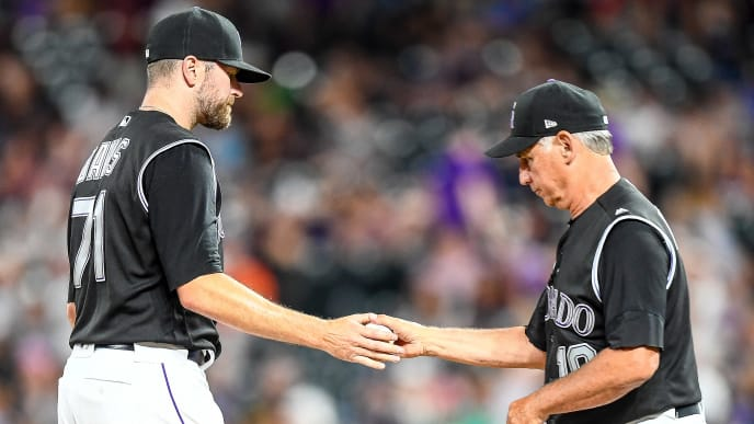 DENVER, CO - JULY 16:  Manager Bud Black #10 of the Colorado Rockies takes Wade Davis #71 out of the game in the 10th inning against the San Francisco Giants at Coors Field on July 16, 2019 in Denver, Colorado. (Photo by Dustin Bradford/Getty Images)