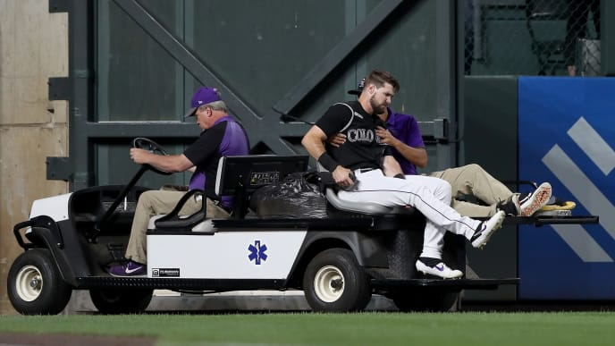 DENVER, COLORADO - AUGUST 02: David Dahl #26 of the Colorado Rockies is carted off the field after being injured in the sixth inning against the San Francisco Giants at Coors Field on August 02, 2019 in Denver, Colorado. (Photo by Matthew Stockman/Getty Images)