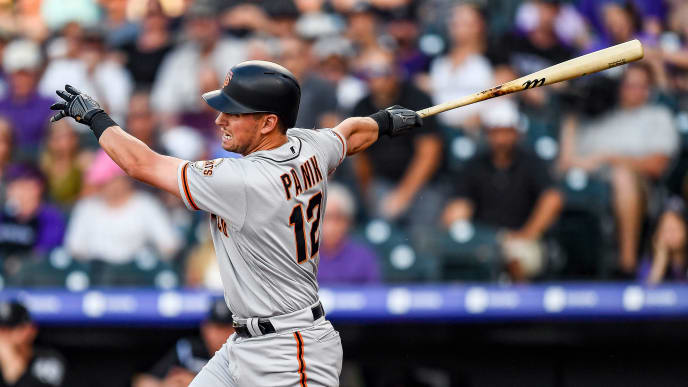 DENVER, CO - JULY 16:  Joe Panik #12 of the San Francisco Giants hits an RBI single in the second inning against the Colorado Rockies at Coors Field on July 16, 2019 in Denver, Colorado. (Photo by Dustin Bradford/Getty Images)