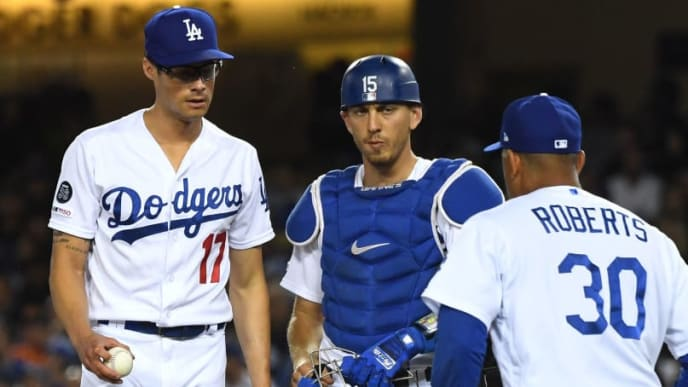 LOS ANGELES, CA - APRIL 01: Austin Barnes #15 looks on as manager Dave Roberts #30 pulls Joe Kelly #17 of the Los Angeles Dodgers in the seventh inning of the game against the San Francisco Giants at Dodger Stadium on April 1, 2019 in Los Angeles, California. (Photo by Jayne Kamin-Oncea/Getty Images)