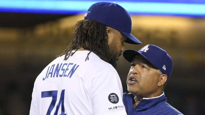 LOS ANGELES, CA - JUNE 20: Manager Dave Roberts #30 of the Los Angeles Dodgers has a conversation with releif pitcher Kenley Jansen #74 in the ninth inning against the San Francisco Giants at Dodger Stadium on June 20, 2019 in Los Angeles, California. Dodgers won 9-8. (Photo by John McCoy/Getty Images)