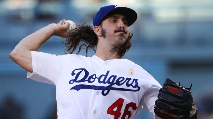 LOS ANGELES, CALIFORNIA - SEPTEMBER 07: Pitcher Tony Gonsolin #46 of the Los Angeles Dodgers pitches during the first inning of the MLB game against the San Francisco Giants at Dodger Stadium on September 07, 2019 in Los Angeles, California. (Photo by Victor Decolongon/Getty Images)