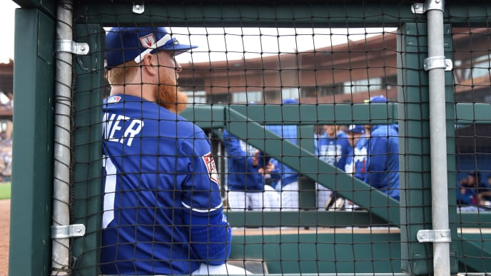 GLENDALE, ARIZONA - MARCH 11: Justin Turner #10 of the Los Angeles Dodgers sits on the dugout steps prior to a spring training game against the San Francisco Giants at Camelback Ranch on March 11, 2019 in Glendale, Arizona. (Photo by Norm Hall/Getty Images)