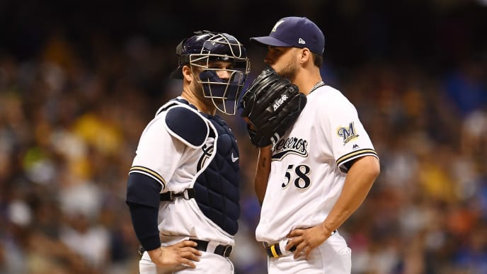MILWAUKEE, WISCONSIN - JULY 13:  Alex Claudio #58 of the Milwaukee Brewers speaks with Manny Pina #9 during the seventh inning against the San Francisco Giants at Miller Park on July 13, 2019 in Milwaukee, Wisconsin. (Photo by Stacy Revere/Getty Images)