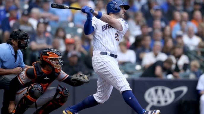 MILWAUKEE, WI - SEPTEMBER 08:  Travis Shaw #21 of the Milwaukee Brewers hits a home run in the first inning against the San Francisco Giants at Miller Park on September 8, 2018 in Milwaukee, Wisconsin. (Photo by Dylan Buell/Getty Images)