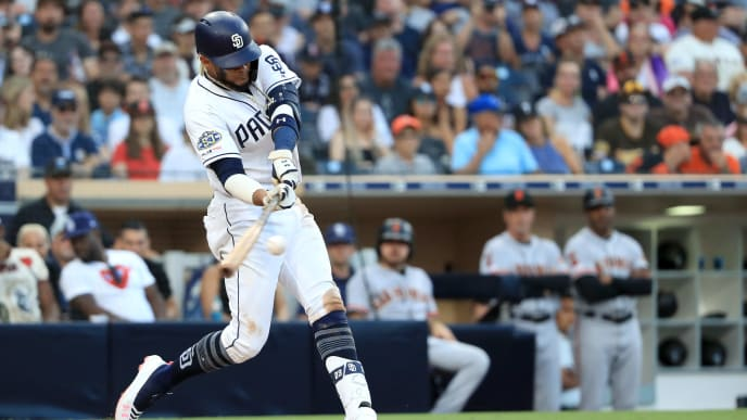 SAN DIEGO, CALIFORNIA - JULY 27:  Fernando Tatis Jr. #23 of the San Diego Padres hits a two-run homerun during the fifth inning of a game against the San Francisco Giantsat PETCO Park on July 27, 2019 in San Diego, California. (Photo by Sean M. Haffey/Getty Images)