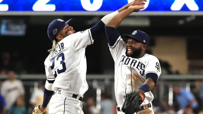 SAN DIEGO, CALIFORNIA - JULY 27:  Fernando Tatis Jr. #23 and Manuel Margot #7 of the San Diego Padres celebrate after defeating the San Francisco Giants 5-1  in a game at PETCO Park on July 27, 2019 in San Diego, California. (Photo by Sean M. Haffey/Getty Images)