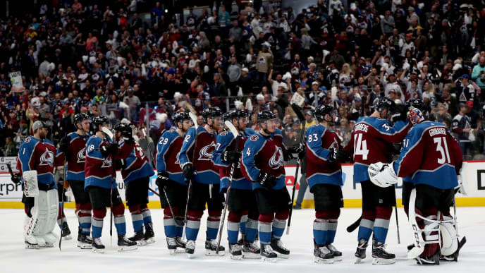 DENVER, COLORADO - MAY 02: Goalie Philipp Grubauer #31 of the Colorado Avalanche is congratulated by his teammates after their shut out win against the San Jose Sharks during Game Four of the Western Conference Second Round during the 2019 NHL Stanley Cup Playoffs at the Pepsi Center on May 2, 2019 in Denver, Colorado.  (Photo by Matthew Stockman/Getty Images)