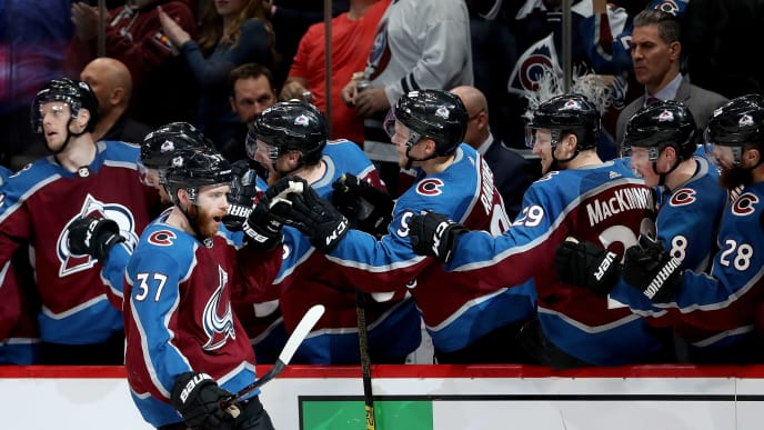 DENVER, COLORADO - MAY 06: J.T. Compher #37 of the Colorado Avalanche is congratulated by his teammates after scoring a goal against the San Jose Sharks in the third period during Game Six of the Western Conference Second Round during the 2019 NHL Stanley Cup Playoffs at the Pepsi Center on May 6, 2019 in Denver, Colorado. (Photo by Matthew Stockman/Getty Images)
