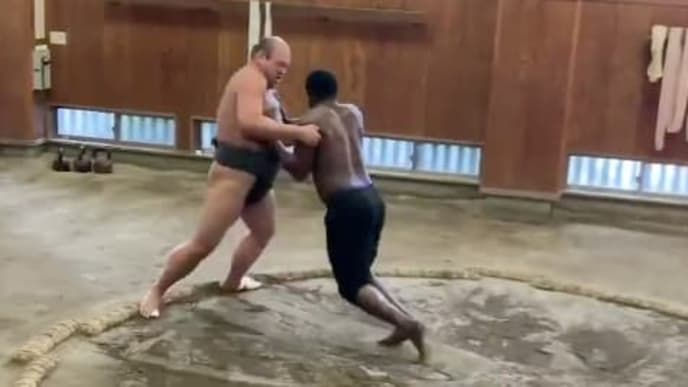 Yasiel Puig in Japan training with a sumo wrestler.
