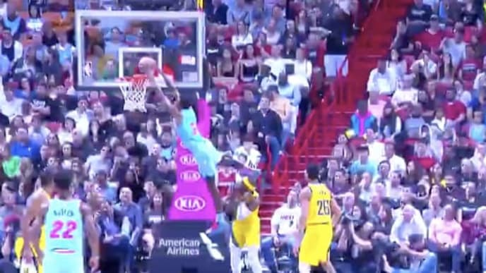 Miami Heat forward Derrick Jones Jr. jumped over Indiana Pacers guard Aaron Holiday while dunking.