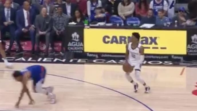 Memphis Grizzlies' Ja Morant hits a 3 after fooling Los Angeles Clippers' Jerome Jerome Robinson.
